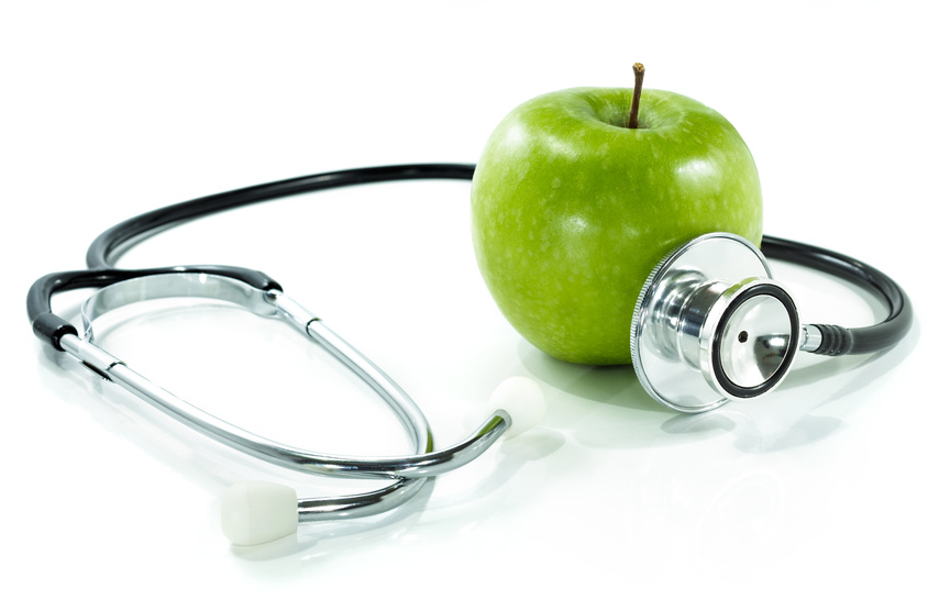 protect your health with healthy nutrition.Stethoscope, apple